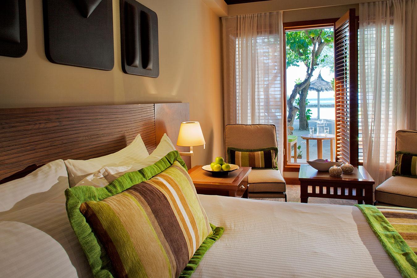 Kurumba Maldives - Deluxe Room Bedroom image  - Maldives Resort